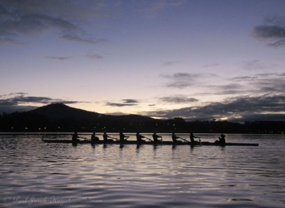 The V8 sculls tearing up the lake.