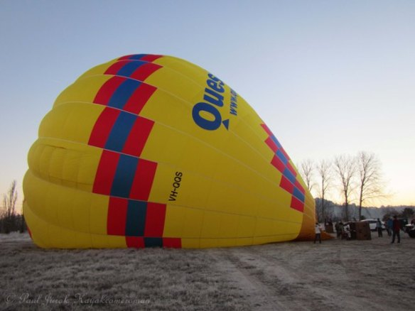 The balloon is filled with cold air first by two large fans.
