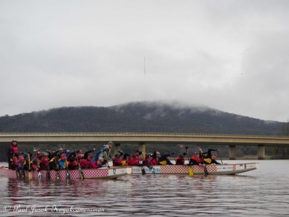 The dragonboaters tearing up the lake.