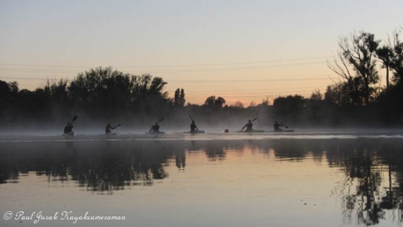'The Mist Busters' - The crew from The Burley Griffin Canoe Club tearing up the river.