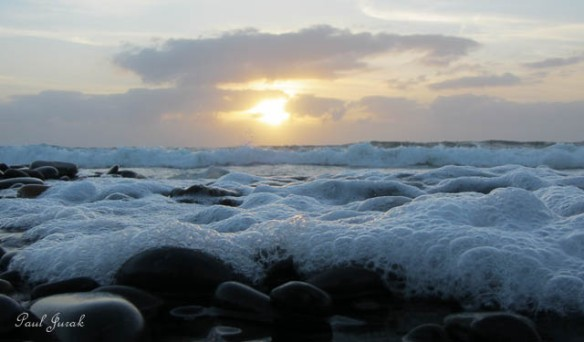 The sounds of the waves crashing on the shoreline were so calming.