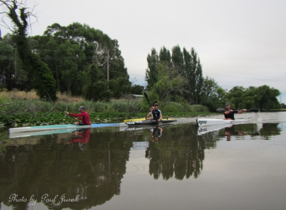 The guys from the Burley Griffin Canoe club are tearing past me as usual.