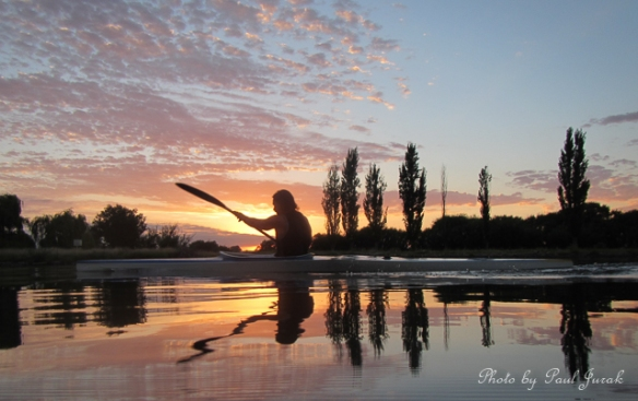 Paddling into a stunning sunrise.