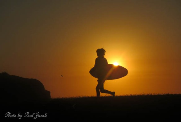 Surfing a golden sunrise
